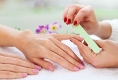 Gentle care of nails in a beauty salon Stock Image
