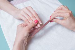 Gentle care of nails in a salon Royalty Free Stock Images