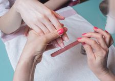 Gentle care of nails in a salon Stock Image