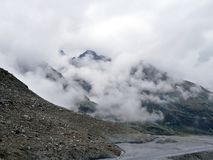Clouds in mountains. Gentle clouds in front of mountain Royalty Free Stock Photography