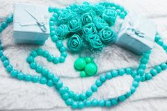 Delicate composition of costume jewelry color of mint and turquoise. Gentle color composition of mint and turquoise jewelry. Beads and roses from the box as a Royalty Free Stock Photo