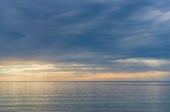 Gentle colors of sea on sunset. With low clouds and water mist Royalty Free Stock Images