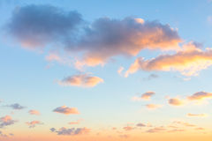 Gentle colors of sunrise sky with  light clouds - background Stock Photo