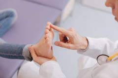 Gentle competent rheumatologist running diagnostic procedure Royalty Free Stock Image