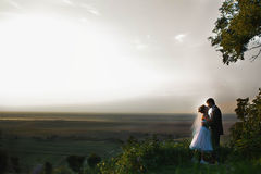 Gentle couple hugging and kissing on the background skyline and Stock Photo