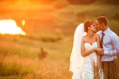 Gentle couple is kissing on the background beautiful sunset Stock Images