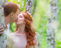 Gentle couple kissing outdoors Royalty Free Stock Photography