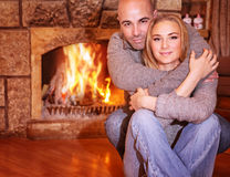 Gentle couple near fireplace Royalty Free Stock Image