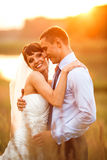 Gentle couple is posing on the background beautiful sunset Royalty Free Stock Photography