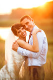 Gentle couple is posing on the background beautiful sunset Stock Images