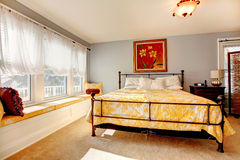 Gentle cozy bedroom with rustic iron frame bed Royalty Free Stock Photography