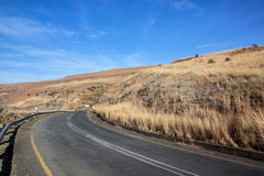 Gentle Curving Asphalt Road at Start of Mountain Pass Stock Photo