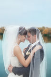 Gentle embrace bride and groom. Groom kissgroom kiss on the pier Stock Photo