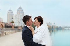 Gentle embrace bride and groom. Groom kissgroom kiss on the pier Royalty Free Stock Image