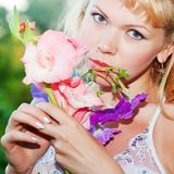 Gentle erotic woman with flowers Royalty Free Stock Photography