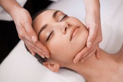 Gentle face massage for beautiful girl. Stock Photography