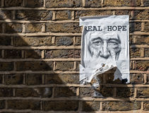 Gentle-face on a poster evoking real hope, brick lane, london Royalty Free Stock Image