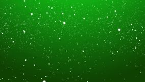 Falling Snow over Green Looping Christmas Background. Gentle Falling Snow on Green Looping Winter Holiday Background stock video footage