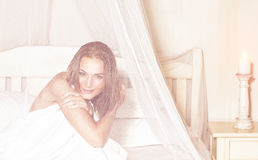 Gentle female in the bedroom Stock Photography