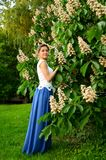 Gentle female portrait in the blooming garden in the spring. royalty free stock photography