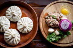 Gentle Georgian khinkali with meat and spices and broth in royalty free stock images