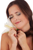 Gentle girl face. Gentle girl's face with lily over white Royalty Free Stock Photos