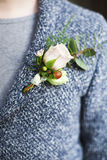 Gentle groom boutonniere with roses and beads Royalty Free Stock Photo
