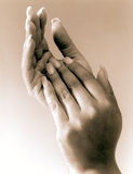 Gentle Hands. African American female hands with polished nails Stock Image