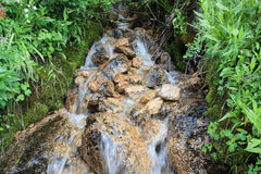 Gentle hillside waterfall Stock Photo