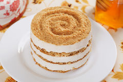 Gentle honey cake with a dollop in still life Royalty Free Stock Image