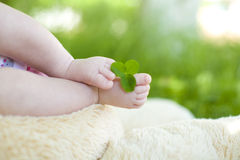 Gentle infantile legs close up Stock Images