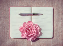 Gentle inspiration. Blank sheets women's diary, pen and flower peony as a symbol of romance and inspiration. The willingness to write essays Royalty Free Stock Photos