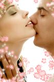 Gentle kiss with flowers Stock Photos