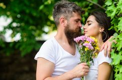 Gentle kiss. Man bearded hipster hugs gorgeous girlfriend. Couple love romantic date nature park background. Love. Relations romantic feelings. Couple in love stock photography