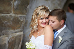 Gentle kiss on the shoulder Stock Image