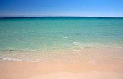 Gentle lapping waves on Tarifa beach in southern Spain Stock Photos
