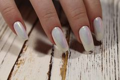 Gentle light manicure. On long beautiful nails Stock Images