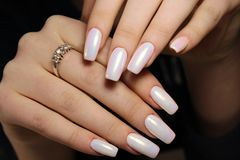 Gentle light manicure. On long beautiful nails Stock Photos