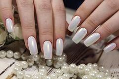 Gentle light manicure. On long beautiful nails Royalty Free Stock Image