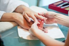 Gentle massage of hands. In the manicure beauty salon Stock Photo