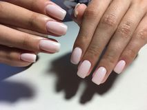 gentle milk manicure of ivory stock images