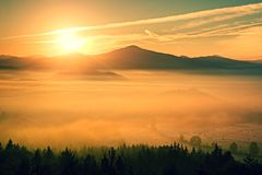 Gentle misty landscape in hilly country. Autumn is beginning.  Retro style filter. Orange toning effect. Royalty Free Stock Photography