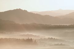 Gentle misty landscape in hilly country. Autumn is beginning.  Retro style filter. Orange toning effect. Stock Images