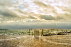 A gentle morning at the seaside. Black Sea. Wooden pier, water from the wave on the pier Stock Image