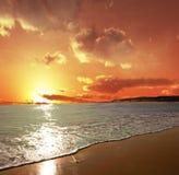 Gentle ocean waves. Bright Sunset behind gentle ocean waves Stock Photos