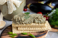 Gentle paste, paste from the eggplant. Dietary dish. Put on a crisp low-calorie diet fitness bread. Stock Images