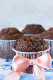 Gentle photo of chocolate muffin. Chocolate muffins on the board written under gzhel Royalty Free Stock Photos