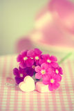Gentle pink flower and heart on table. Royalty Free Stock Images