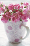 Gentle pink pastel flower in pink cup. Shallow depth of field Stock Photography