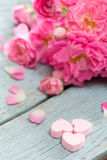 Gentle pink rose and heart on wooden table Royalty Free Stock Image